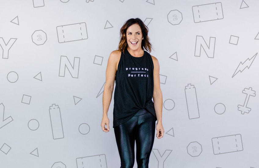 Spin Instructor Standing In front of backdrop