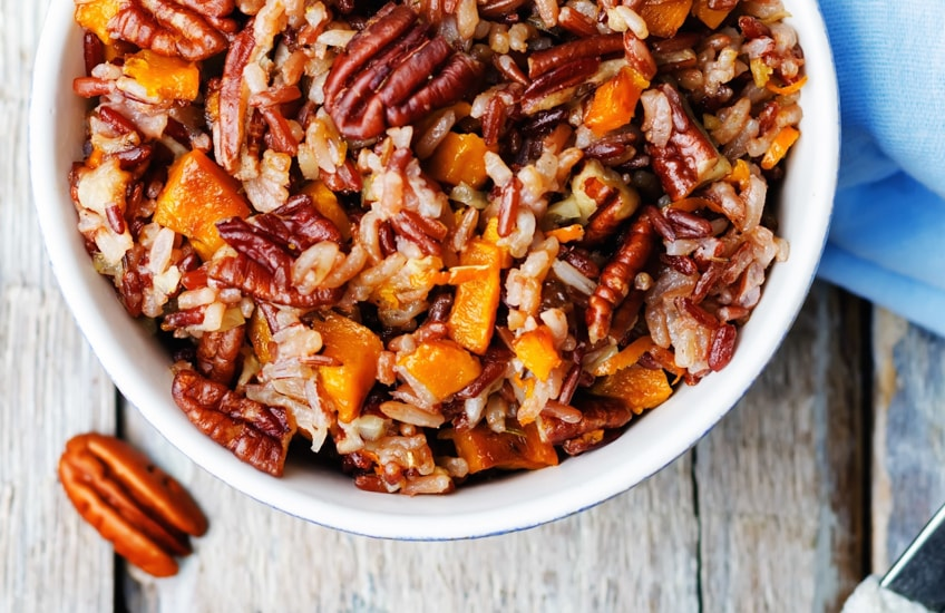 a photo of a plate of sweet potatoes and pecans